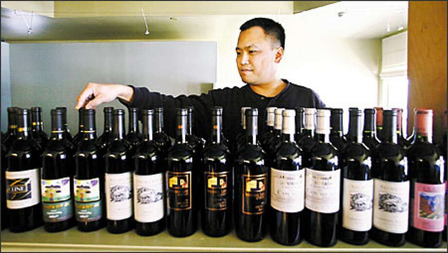 Shing Chin's Ovio Bistro is a welcoming place for wine lovers with its 60-some varieties and minimum markup. Photo: Jim Bryant, Seattle Post-Intelligencer / Seattle Post-Intelligencer