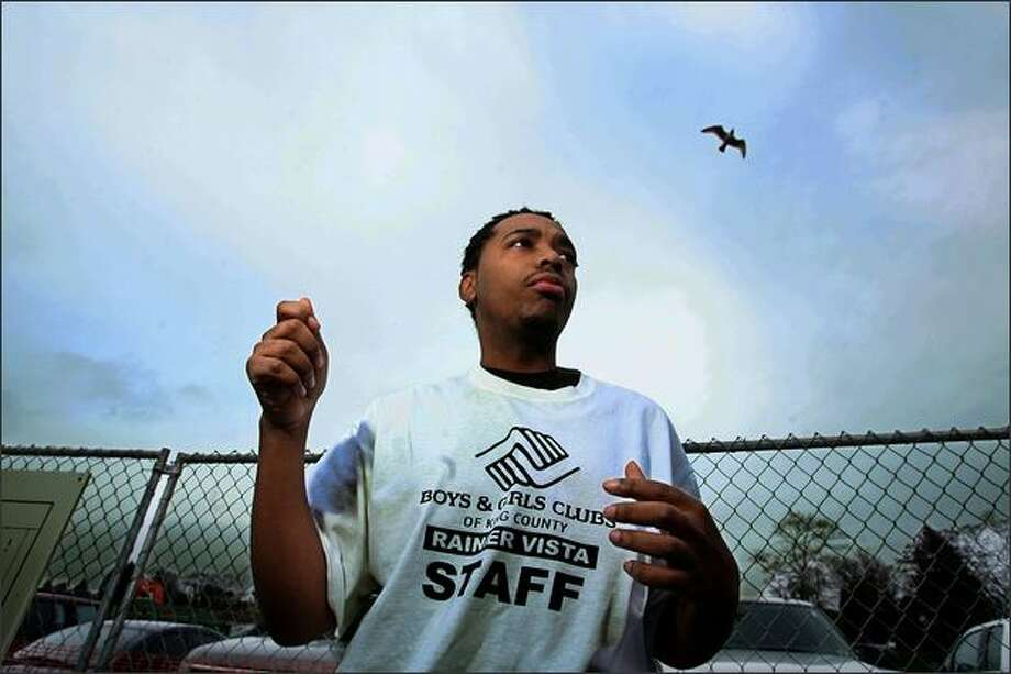 "Boys & Girls Club employee Romelle Bradford, the state's Youth of the Year in 2003, stands on the spot on Martin Luther King Jr. Way South where Seattle Officer Jacob Briskey arrested him for ""obstructing."" Photo: Scott Eklund, Seattle Post-Intelligencer / Seattle Post-Intelligencer"