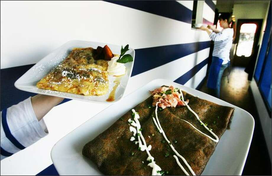 A caramelized apple crepe, left, and a ham and cheese crepe made with buckwheat batter are two of the better plates at La Cote Creperie. Photo: Dan DeLong, Seattle Post-Intelligencer / Seattle Post-Intelligencer