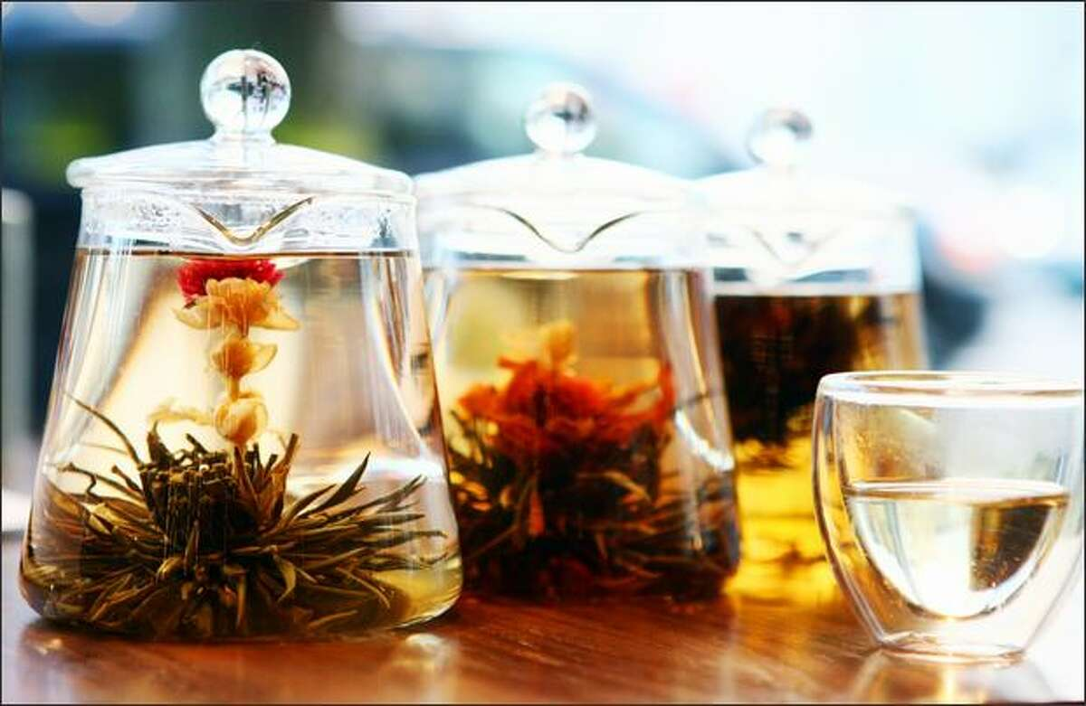 Gorgeous flowering teas blossom while steeping. From left are Jasmine Pearl, Blooming Heart and Fairy Peach Pearl Black.
