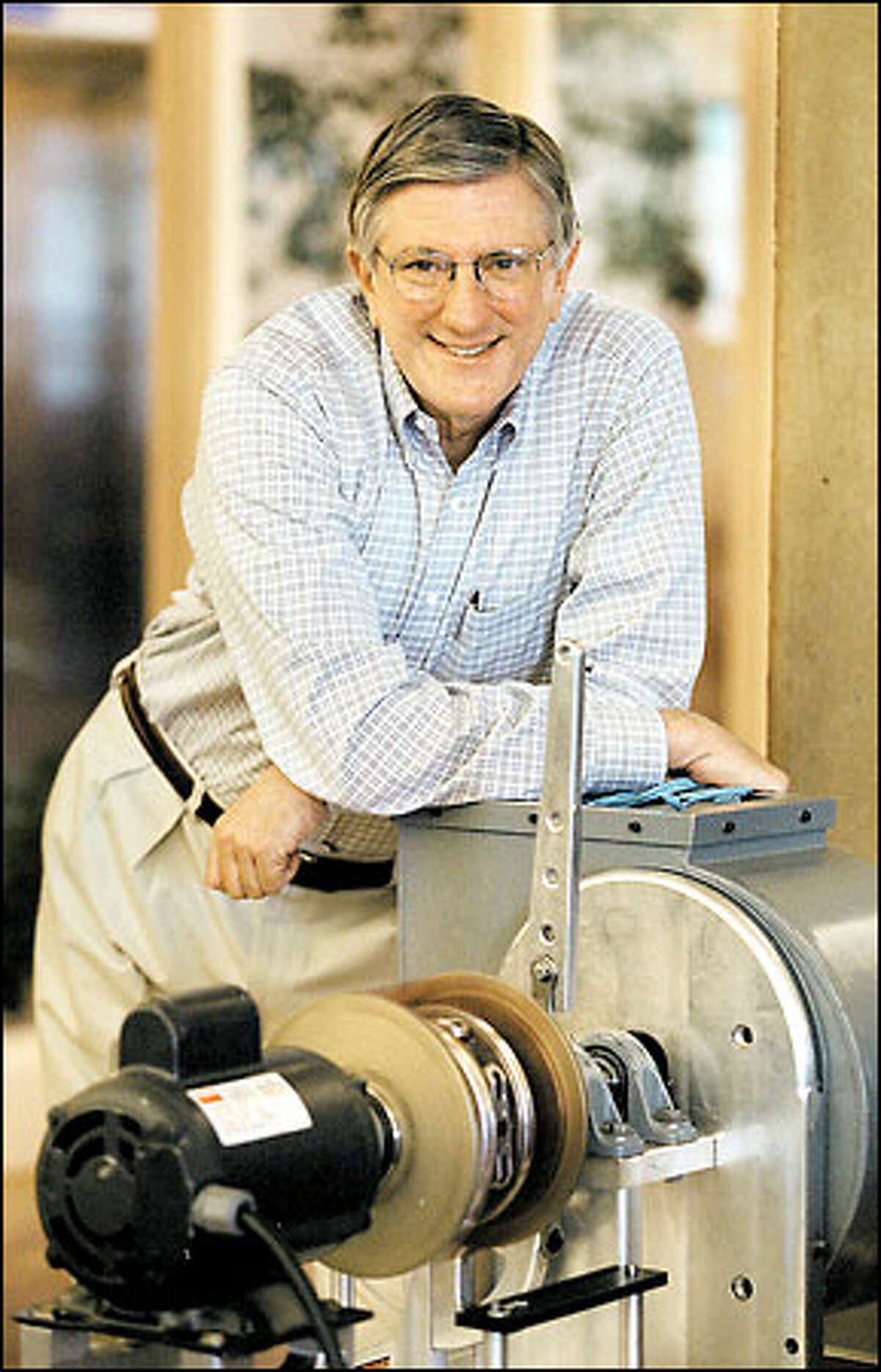 Ron Woodard, former head of Boeing Commercial Airplanes, is now president and CEO of MagnaDrive of Seattle. Here he is shown with a MagnaDrive Adjustable Speed Drive.