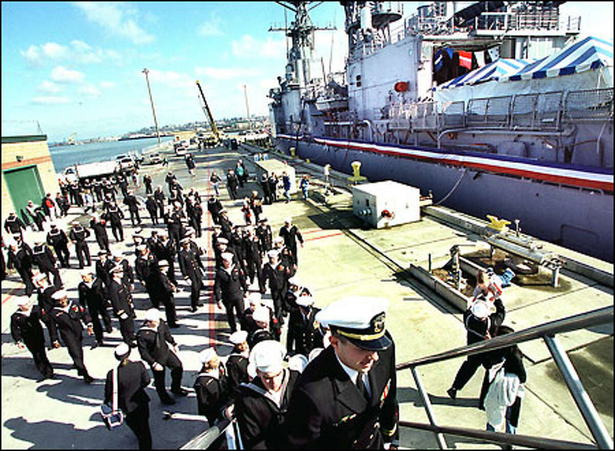 Well-wishers, about 100 of them, say goodbye to the USS David R. Ray yesterday. The destroyer was decommissioned at the Everett Naval Station.