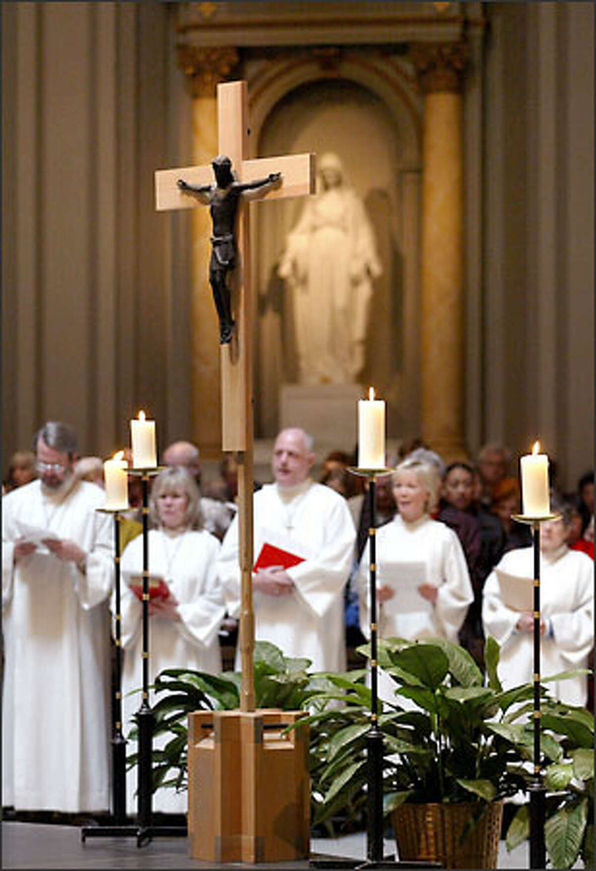 The congregation at St. James Cathedral celebrates the first Sunday Mass of Lent yesterday.