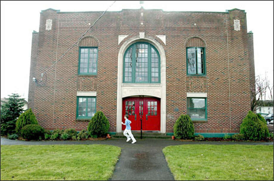 The private Thomas Academy has withstood the vagaries of the region's economy and demographics for 40 years. But declining enrollment is finally forcing the Auburn school to close and sell its old building. Photo: Gilbert W. Arias, Seattle Post-Intelligencer / SEATTLE POST- INTELLIGENCER