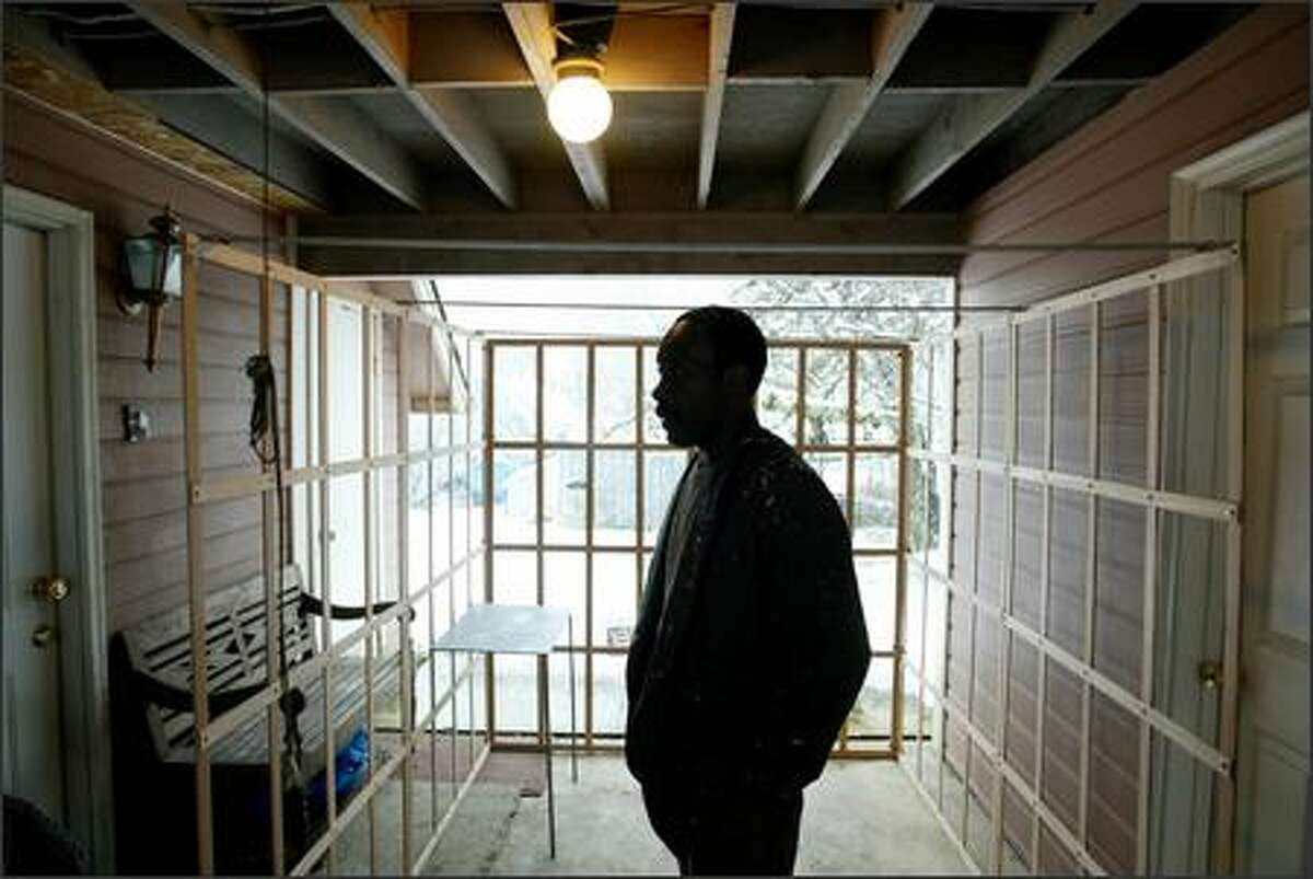 """Willie Robinson, who performs a play about his 20 years of incarceration for murder, is shown Wednesday at his Lake Stevens home in the """"cell"""" he built as the set for the play. It was written by Lea Zengage, a founder of the inmate advocacy group Justice Works!"""