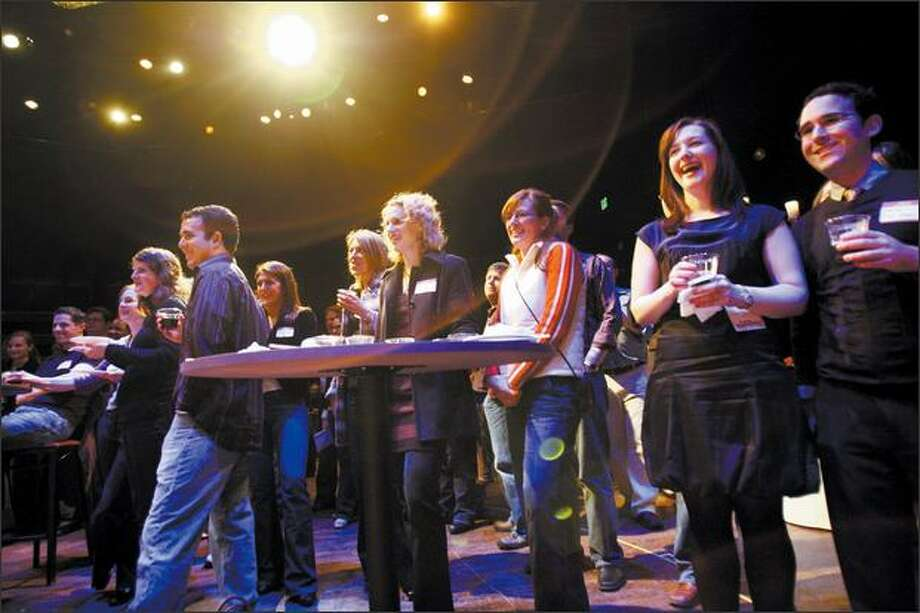 Members of The Crew -- Seattle Rep's under-40 season-ticket holders -- laugh at Jet City Improv during a pre-play party. Photo: Karen Ducey, Seattle Post-Intelligencer / Seattle Post-Intelligencer