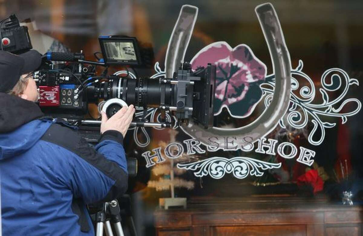 A camera crew shoots a scene during filming of the movie