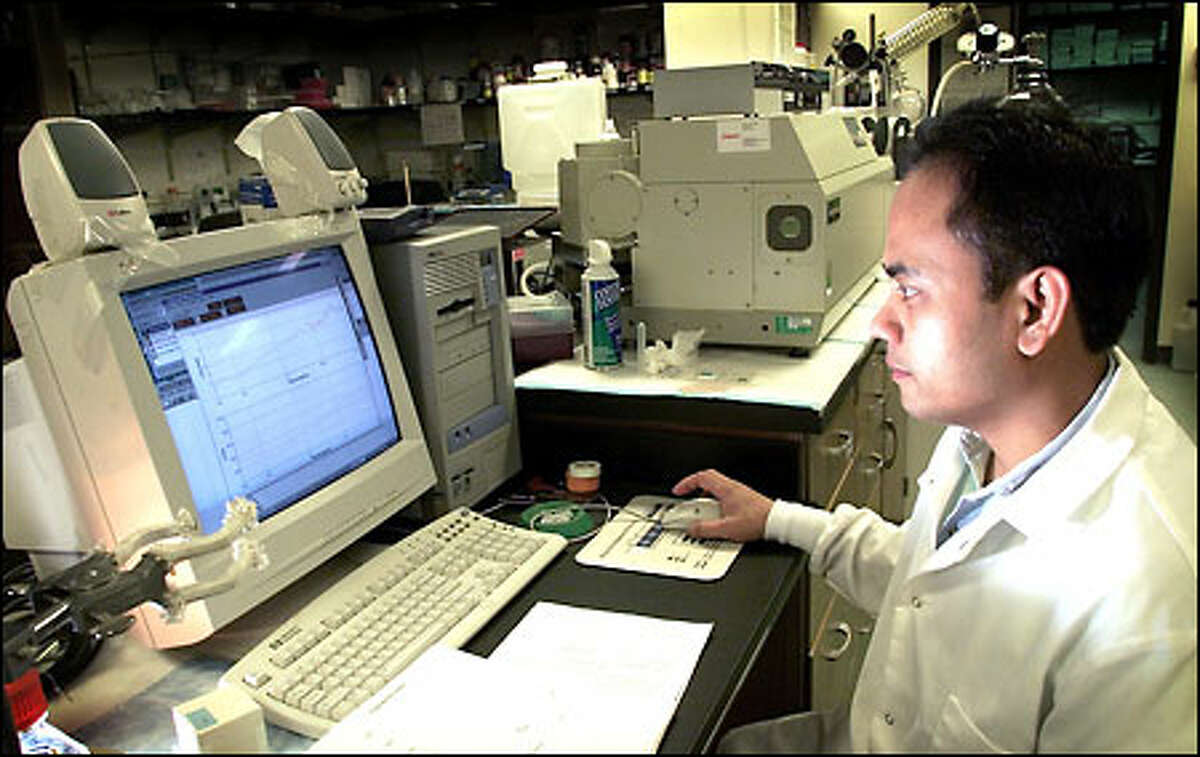 Gerry Castillo, ProteoTech's director of biochemistry, records data while working on the company's developmental drug to treat Alzheimer's.