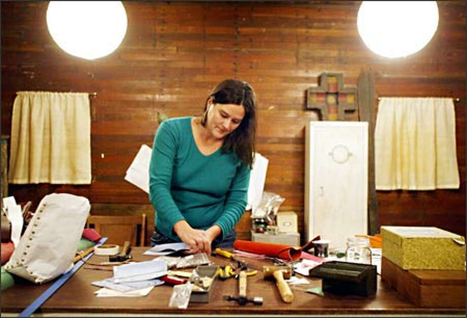 An architect, Aubrey Summers started creating handbags in her spare time a year ago when she couldn't find a style she liked for the bus ride to work Photo: Joshua Trujillo, Seattlepi.com / seattlepi.com