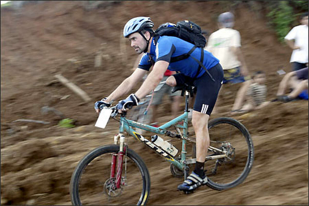 Brett Wolfe, who is missing most of his right leg, hits the mud in last year's grueling La Ruta de los Conquistadores race in Costa Rica.
