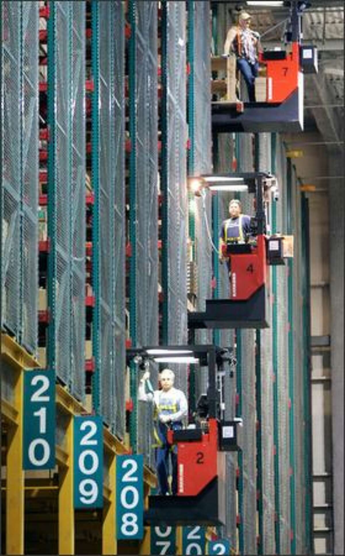 Boeing workers use these lifts to travel up to 60 feet to the top of huge storage bays at the Boeing Spares Distribution Center in SeaTac to fetch parts. The 24 high bay bins, each 60 feet high and 320 feet long, hold 5.9 million cubic feet of storage.