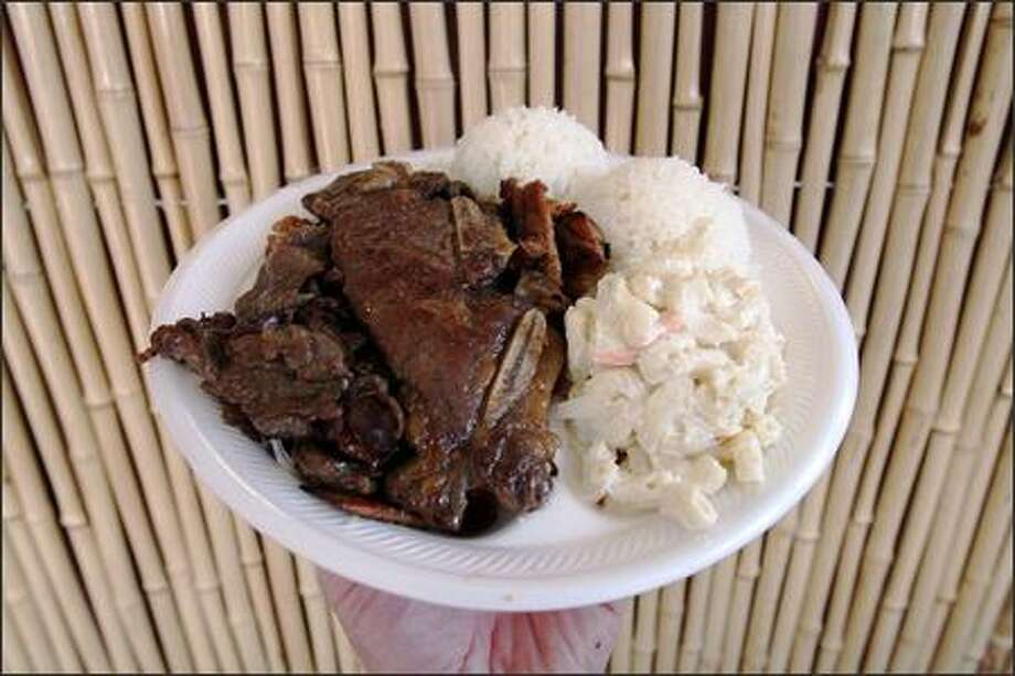 The Hawaiian Barbeque Mix plate ($7.99) features beef, chicken, short ribs, rice and macaroni salad. Photo: Mike Urban, Seattle Post-Intelligencer / Seattle Post-Intelligencer