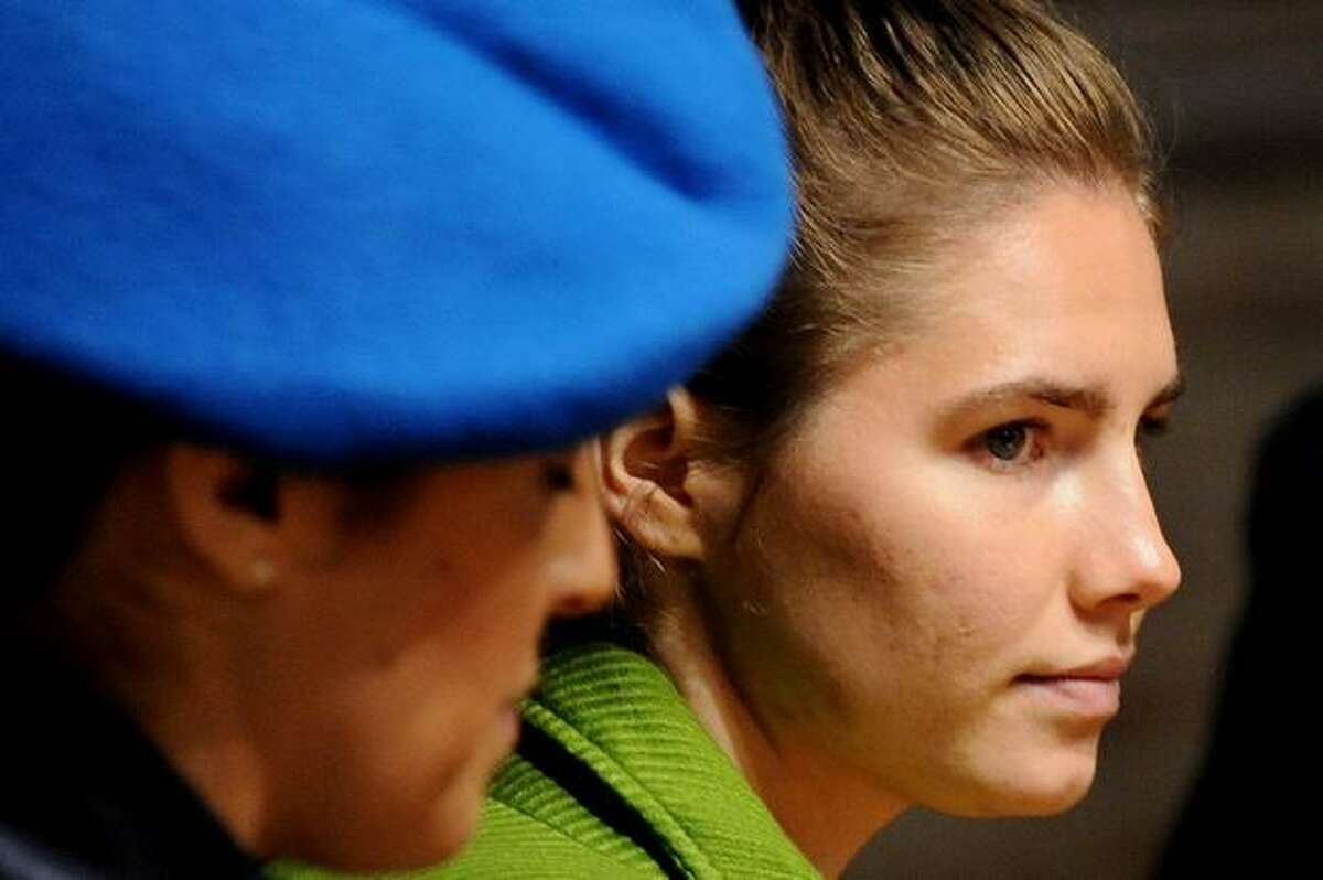 U.S. student Amanda Knox, accused of taking part in the killing of British student Meredith Kercher in 2007, looks on during a session of her trial on December 4, 2009 at the courthouse in Perugia, Italy.