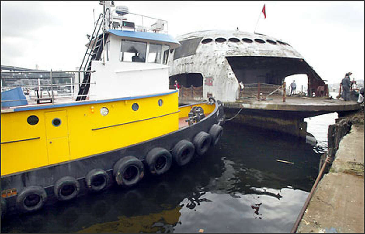 The tugboat Wasp waits to push off the 1930s-era ferry from moorage on Lake Union.