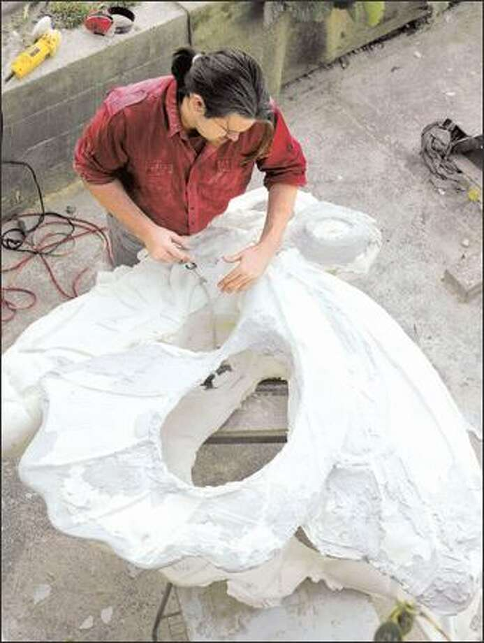 Poulsbo art student Brandon Ramsey, Brent White's nephew, works on a butterfly cast. White's daughter, a student in Oregon, does the painting. Photo: Gilbert W. Arias, Seattle Post-Intelligencer / Seattle Post-Intelligencer