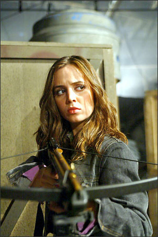 "Renegade Slayer Faith (Eliza Dushku) won't be headlining her own spin-off series, but she will play a key role on ""Buffy the Vampire Slayer"" and ""Angel"" starting this week. Photo: The WB / The WB"