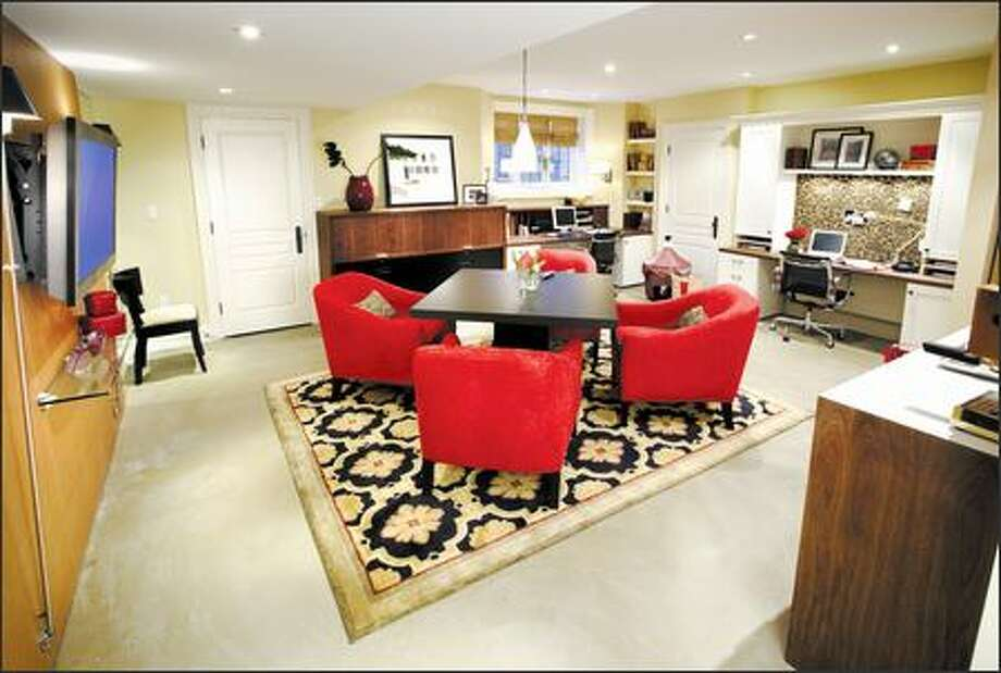 A lifeless space was transformed into a showroom/office where the owners can entertain clients. Photo: HGTV / HGTV