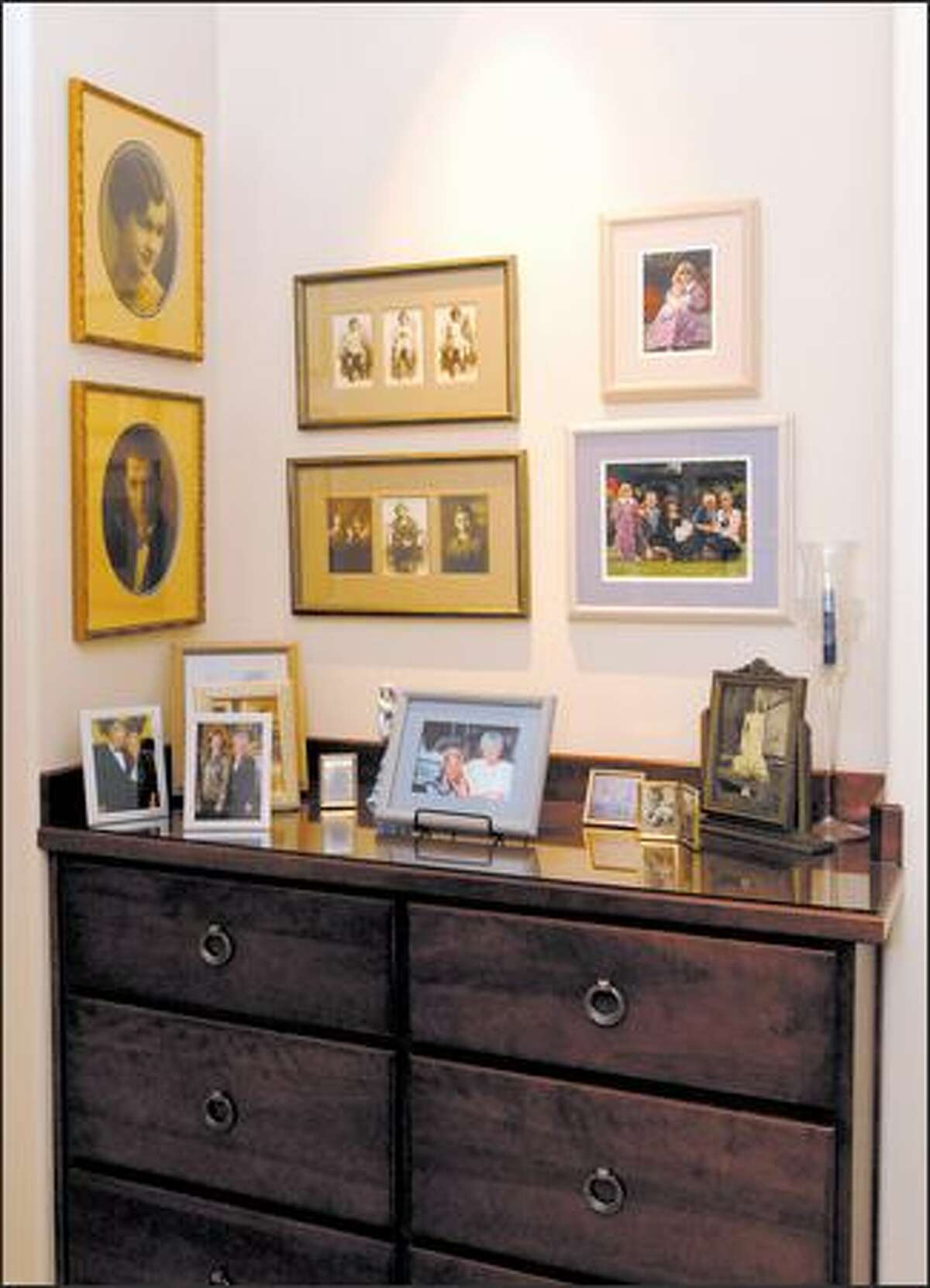 Group pictures according to frames, style and content, says John Willis, owner of Amiker Designs & Custom Framing.