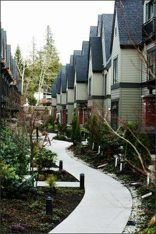 In this high-end row house project at 1200 Bellevue Way cars and storage closets are tucked away below the complex. Photo: Gilbert W. Arias, Seattle Post-Intelligencer / Seattle Post-Intelligencer