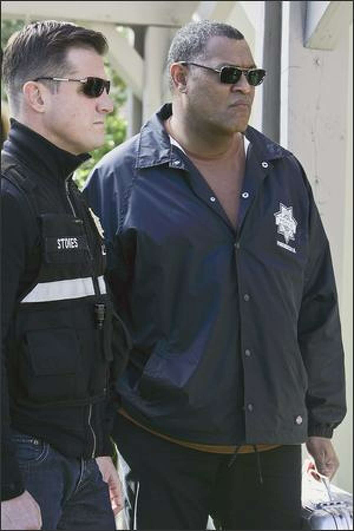 Ray Langston (Laurence Fishburne, right) is the new sheriff in town on