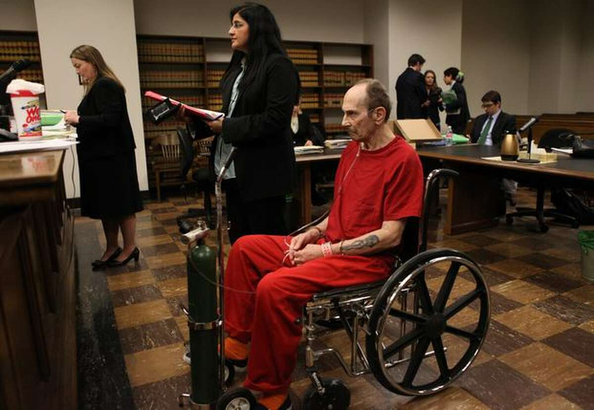 """James Fogle, also known as the """"Drugstore Cowboy,"""" listens to his attorney Anna Samuel address Judge Dean Lum as Fogle is sentenced to 16 years in prison for the robbery of a Redmond drugstore in May 2010."""
