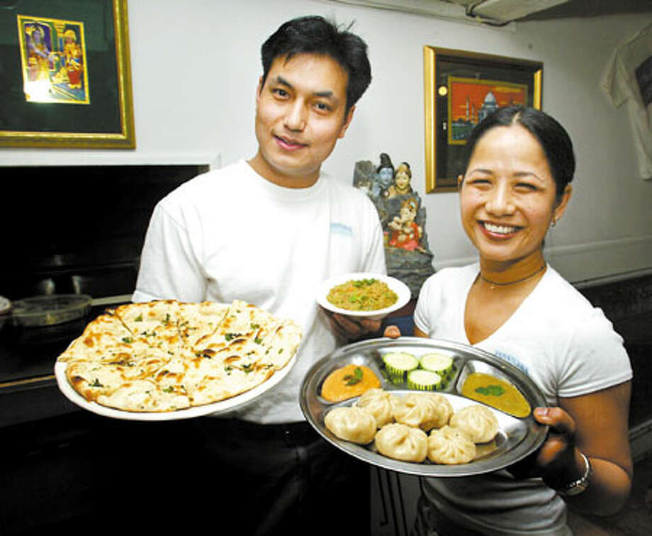 Bharta dip, left, and Tensing momo are favorites at the Annapurna Cafe, owned by brother and sister Kumar, left and Roshita Shreshta. The momos also are available in spinach. Photo: Grant M. Haller, Seattle Post-Intelligencer / Seattle Post-Intelligencer