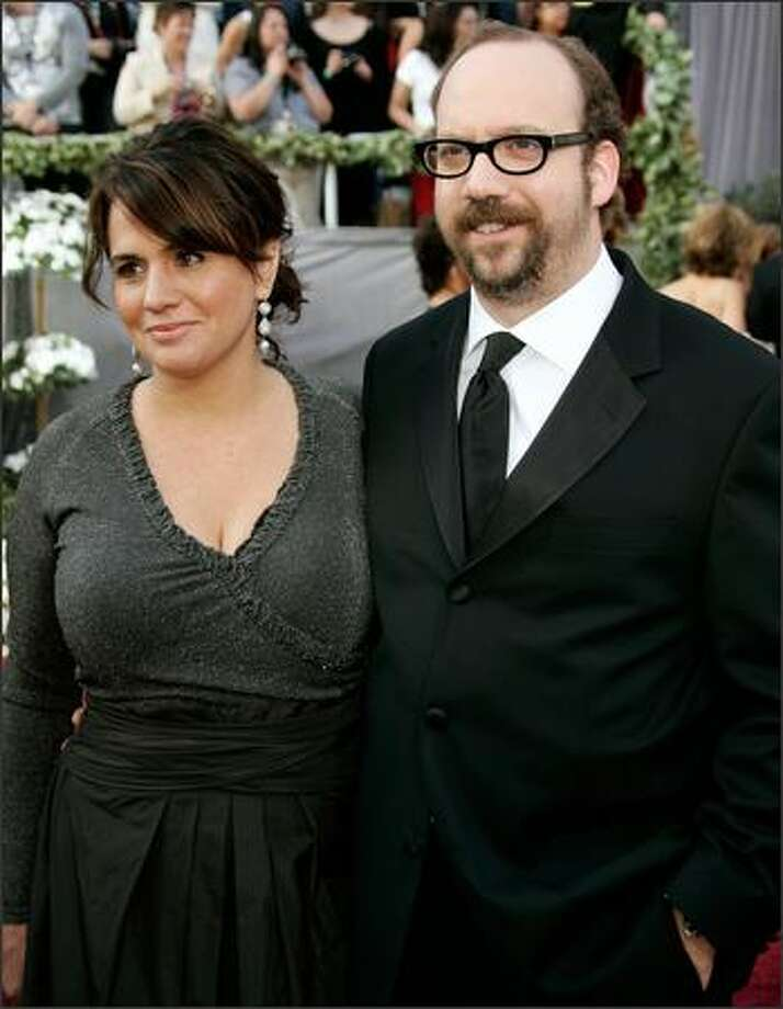 "Paul Giamatti, nominated for an Oscar for best actor in a supporting role for his work in ""Cinderella Man,"" arrives with his wife Elizabeth Cohen for the 78th Academy Awards. (AP Photo/Kevork Djansezian) Photo: Associated Press / Associated Press"