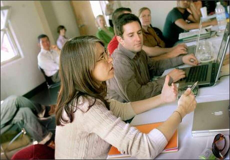 Green MBA student Meg Escobosa explains a project to classmates at the Presidio School of Management in San Francisco. Photo: San Francisco Chronicle / San Francisco Chronicle