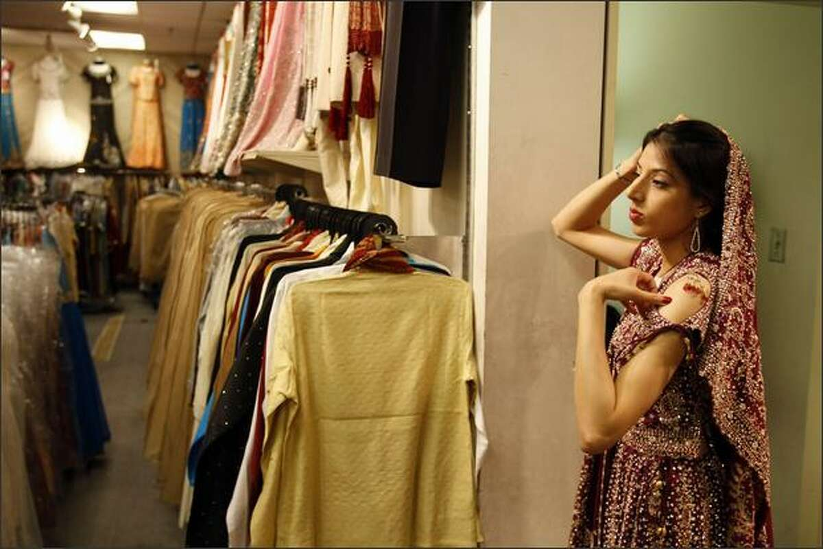 Ambreen Azeem came from Calgary to shop in Vancouver's Little India. She is trying on a wedding dress at Guru Bazaar.