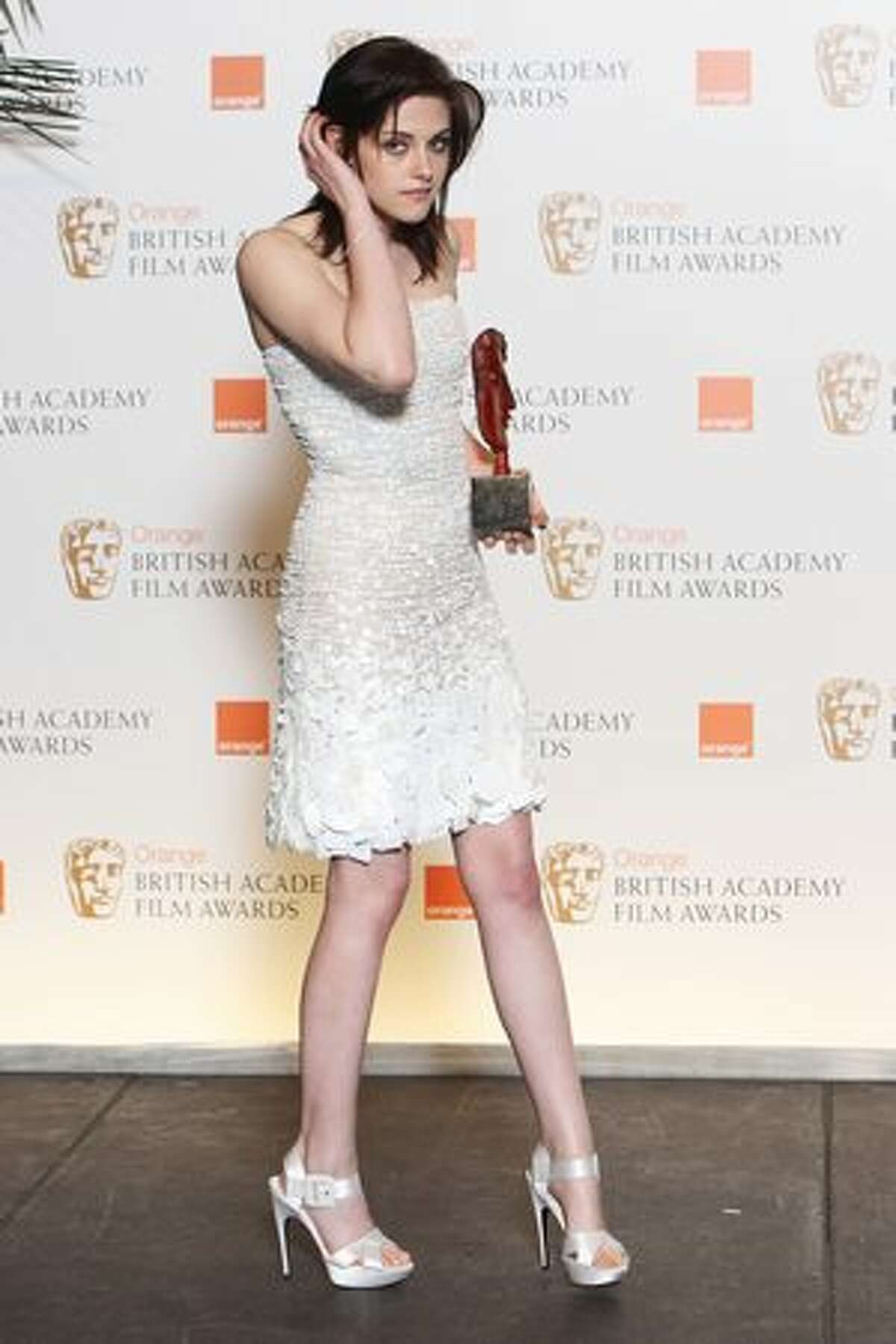Kristen Stewart poses with her rising star award at the Orange British Academy Film Awards in London on Feb. 21.