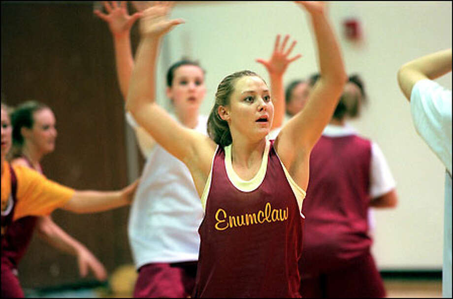 "Enumclaw's leading scorer, junior forward Jenny Poe, keeps hearing about how good she'll be next year as a senior. ""I say, 'Yeah, but it's still this year,'"" she says. Photo: Grant M. Haller, Seattle Post-Intelligencer / Seattle Post-Intelligencer"