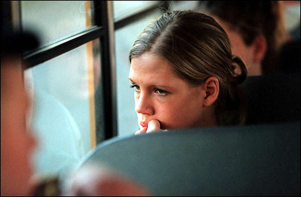 Brooke McCully, a guard for the Enumclaw Hornets, looks out the window of the school bus as her team rides to the Tacoma Dome for a walkabout late Tuesday afternoon.