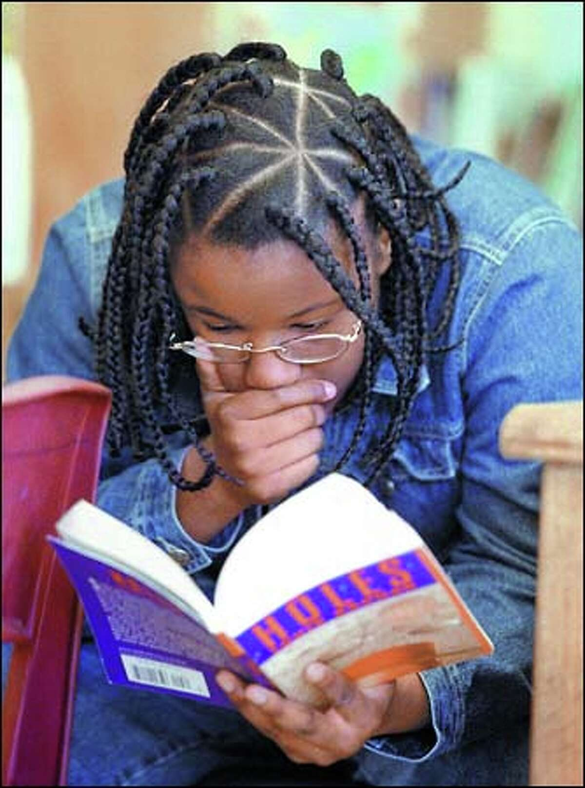 Seventh-grader Tanisha Brown reads