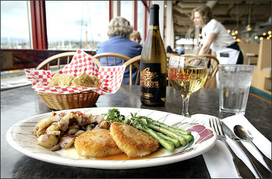 Dungeness crab cakes, priced at $18.95, are one of the signature offerings at Chinook's. As a matter of fact, any of the fresh seafood offerings are good choices. Photo: Gilbert W. Arias, Seattle Post-Intelligencer / Seattle Post-Intelligencer