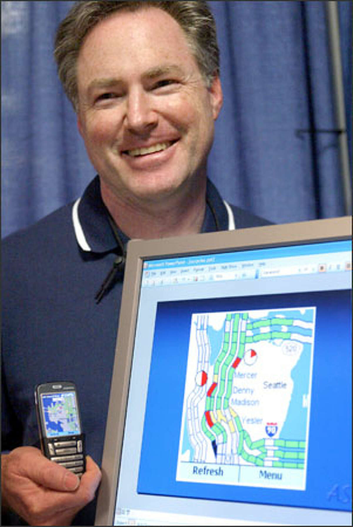 Microsoft researcher Eric Horvitz shows a project that indicates traffic problems on cell phones. The computer program, which also predicts upcoming traffic conditions, already is used by Microsoft employees.