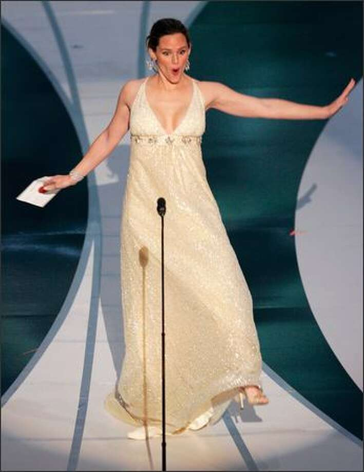 """Whoa, there, Jennifer Garner! You almost tripped into Oscar history Sunday night, but you and your superspy """"Alias"""" balance skills came to the rescue! Nice save. Garner was presenting an award for sound editing, but the guffaws that would have followed such an accident could have blown away the winner. Photo: Associated Press / Associated Press"""