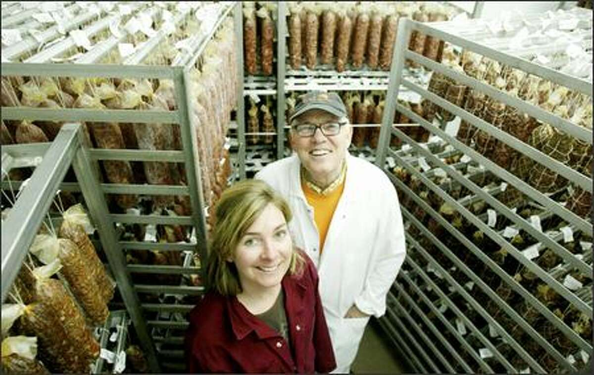 Gina Batali stands in Salumi's new curing room with her father, Armandino Batali. Salumi produces about 2,000 pounds of salami per week.