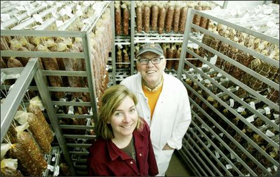 Gina Batali stands in Salumi's new curing room with her father, Armandino Batali. Salumi produces about 2,000 pounds of salami per week. Photo: Paul Joseph Brown, Seattle Post-Intelligencer / Seattle Post-Intelligencer