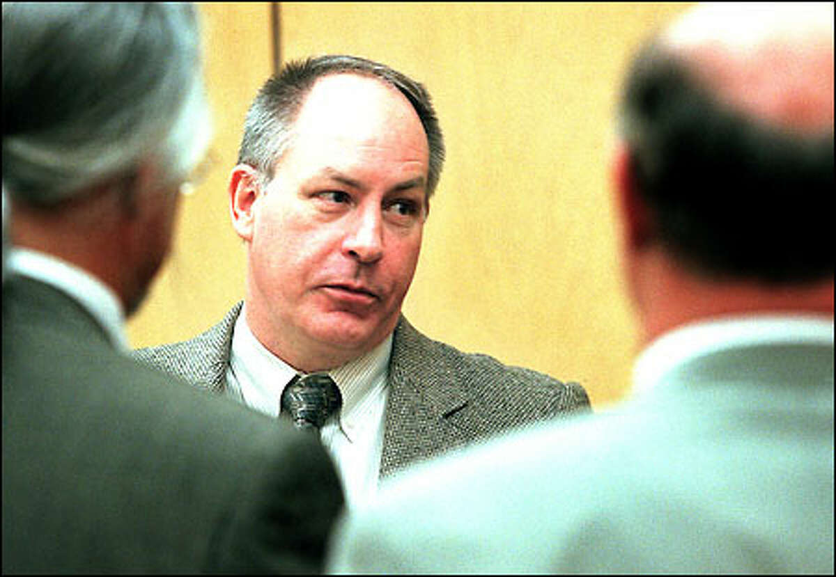 Robert Yates Jr. talks with his attorneys while waiting for a decision.