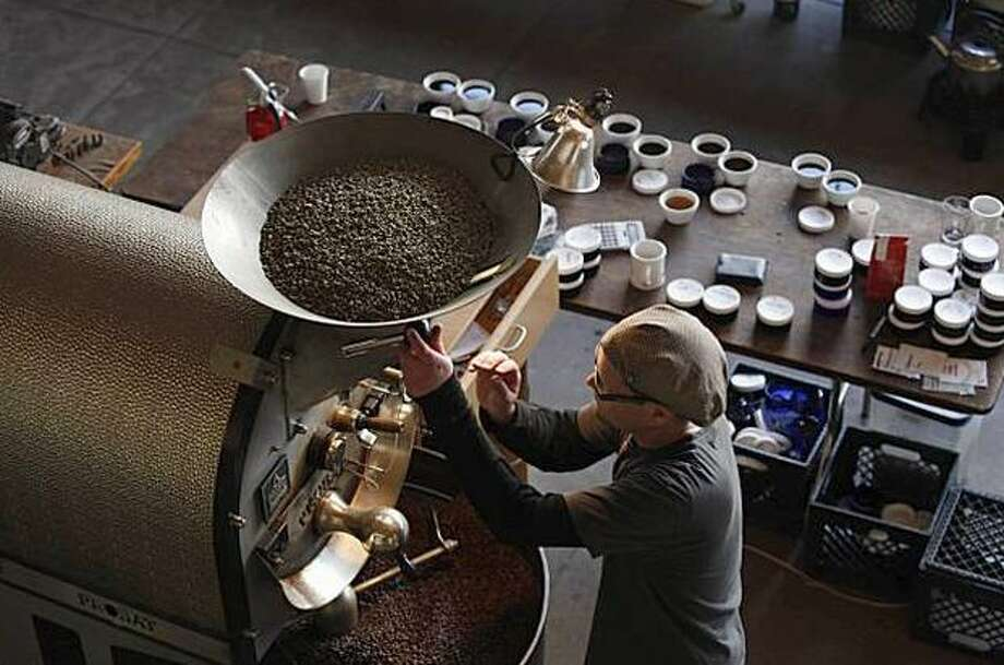 Joel Edwards works the roaster at Ritual Coffee Roasters, which uses GoCoffeeGo. Photo: San Francisco Chronicle / San Francisco Chronicle