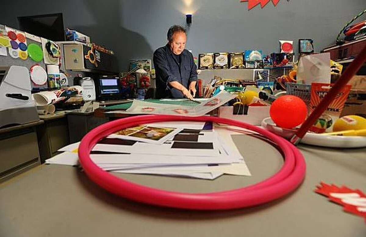 Anthony Neila, surrounded by Wham-O products, designs toy packaging in Emeryville. (Noah Berger/Special to The San Francisco Chronicle)