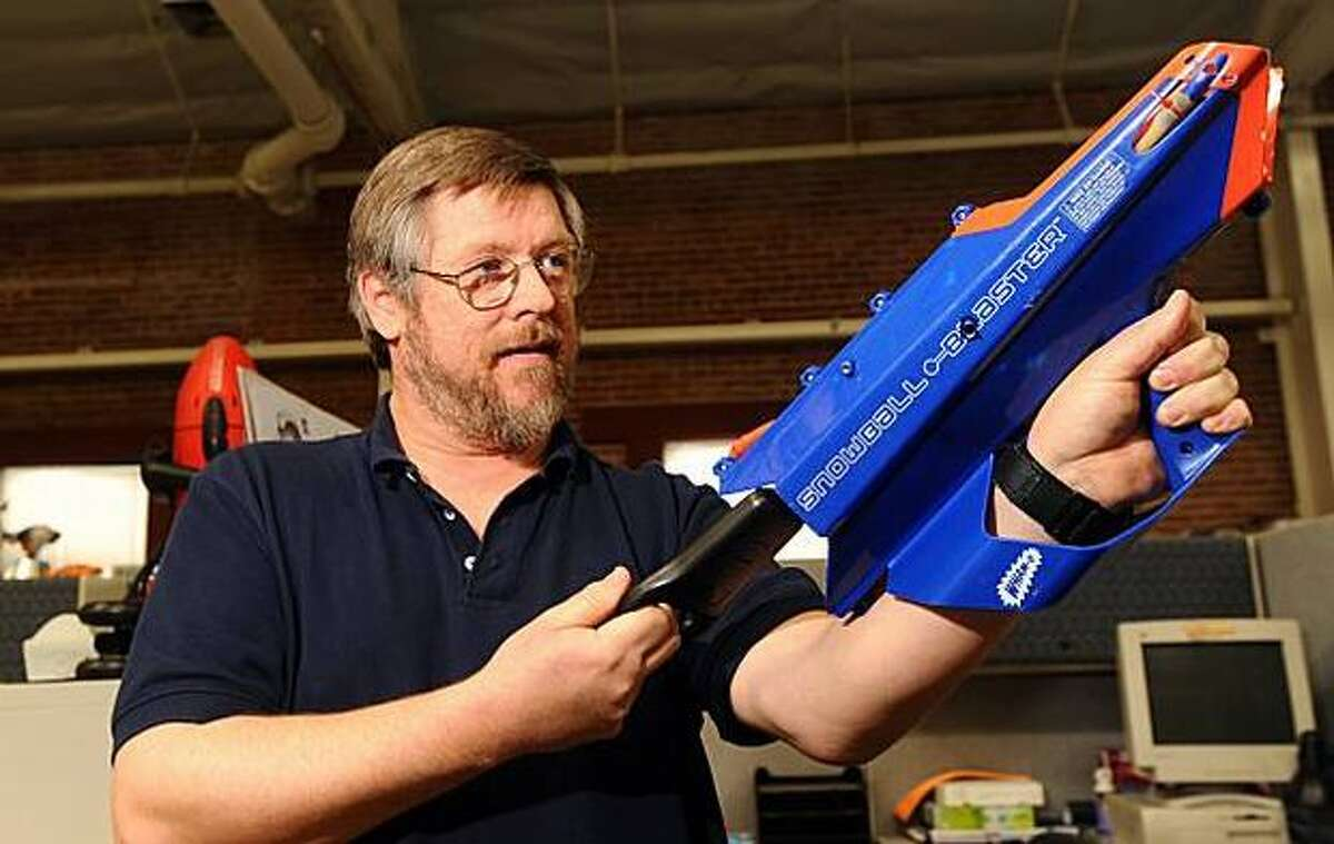 David FitzGerald, a senior product designer at Wham-O, demonstrates how he tests a SnowBall Blaster. (Noah Berger/Special to The San Francisco Chronicle)