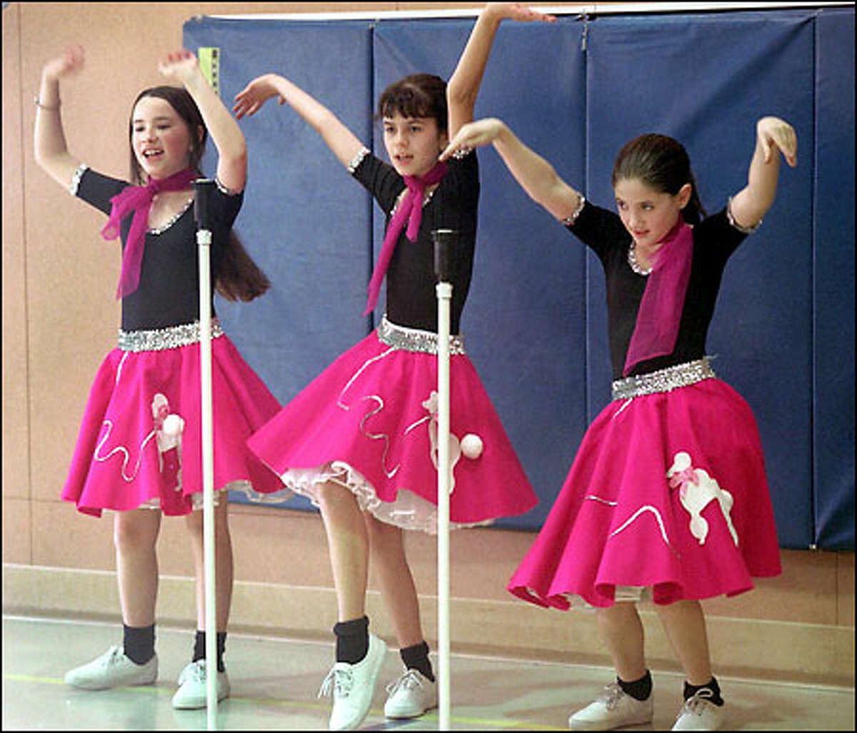 Showing off their moves during a Hilighters song-and-dance number are, from left, Claire Carey, 10, Marina Ponomareva, 11, and Lindsay Sandler, 10.