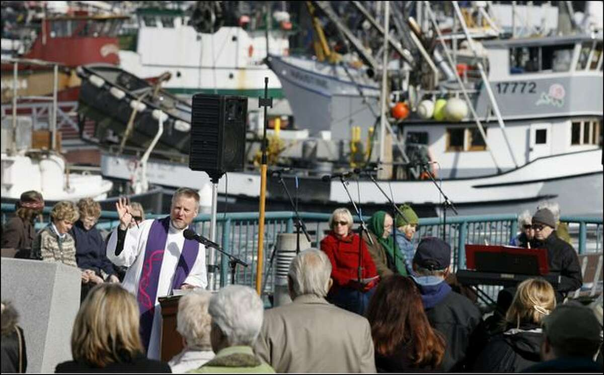 "Pastor Erik Wilson Weiberg of Ballard First Lutheran Church speaks Sunday during the 81st ""Blessing of the Fleet"" at Fishermen's Terminal."