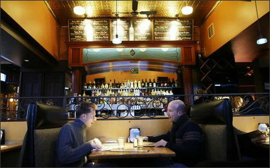 You can't beat the happy hour prices at the Deluxe Bar & Grill on Capitol Hill, with well drinks going for $3 and microbrews just a buck apiece. The food, if a bit hit-or-miss, also goes easy on the pocketbook. Photo: Mike Urban, Seattle Post-Intelligencer / Seattle Post-Intelligencer