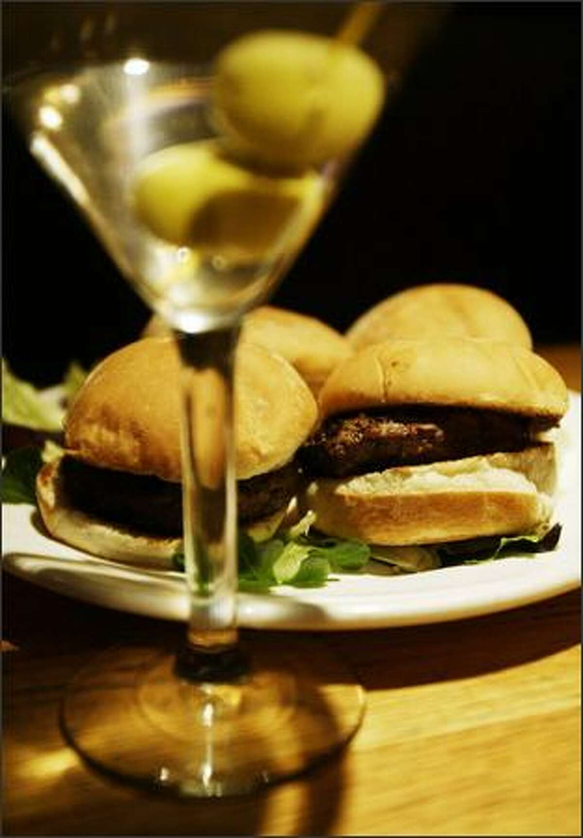 Sliders, or miniburgers, and a martini are great happy hour values.