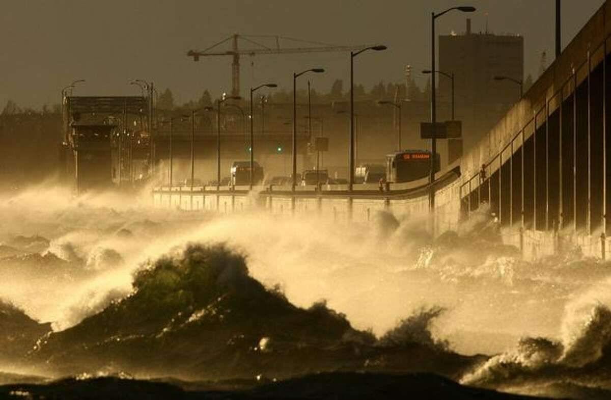 Waves crash on the 520 Bridge over Lake Washington during a windstorm on Thursday.