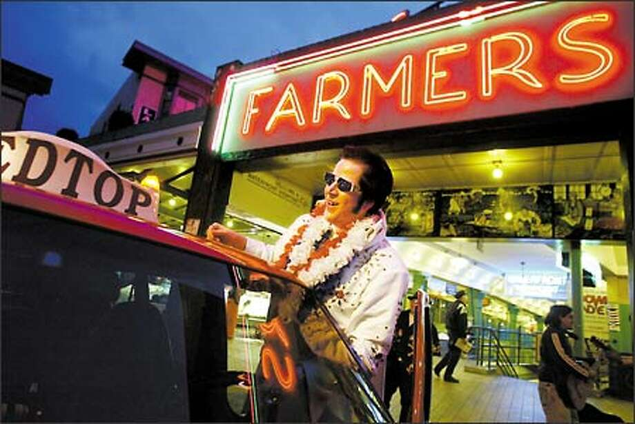 Dave Groh picks up his cab from the day driver at 6 p.m. in front of the Pike Place Market and drives it until 6 a.m. Dave is a minor celebrity at the Market. Photo: Scott Eklund, Seattle Post-Intelligencer / Seattle Post-Intelligencer