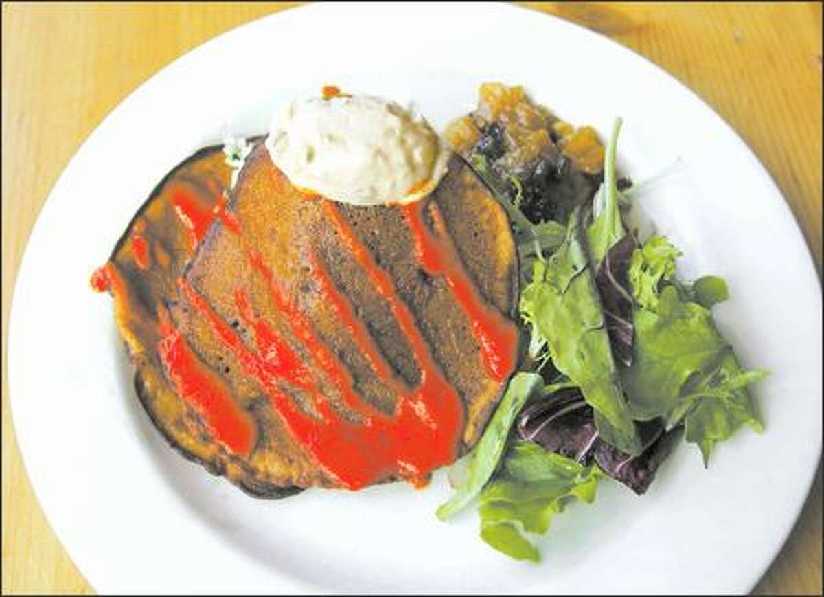 At Cafe Flora, try the savory dosa served over a bed of coconut-minted rice with red pepper cucumber raita, mango-ginger chutney and greens.