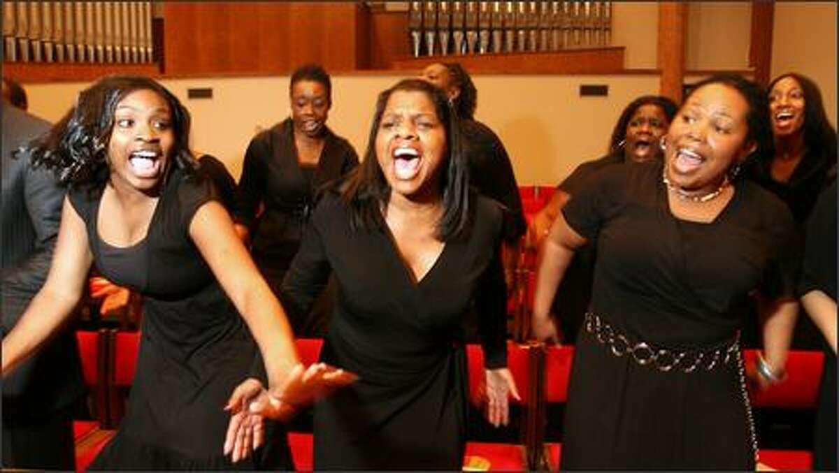 DaNell Daymon & Royalty choir members Kia Pierce, left, Ellan Garvin and Mesha McClaid sing